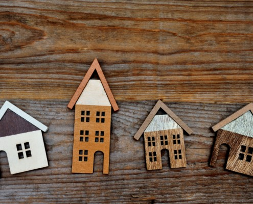 house on brown wooden background